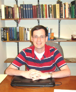 Pastor Will at desk
